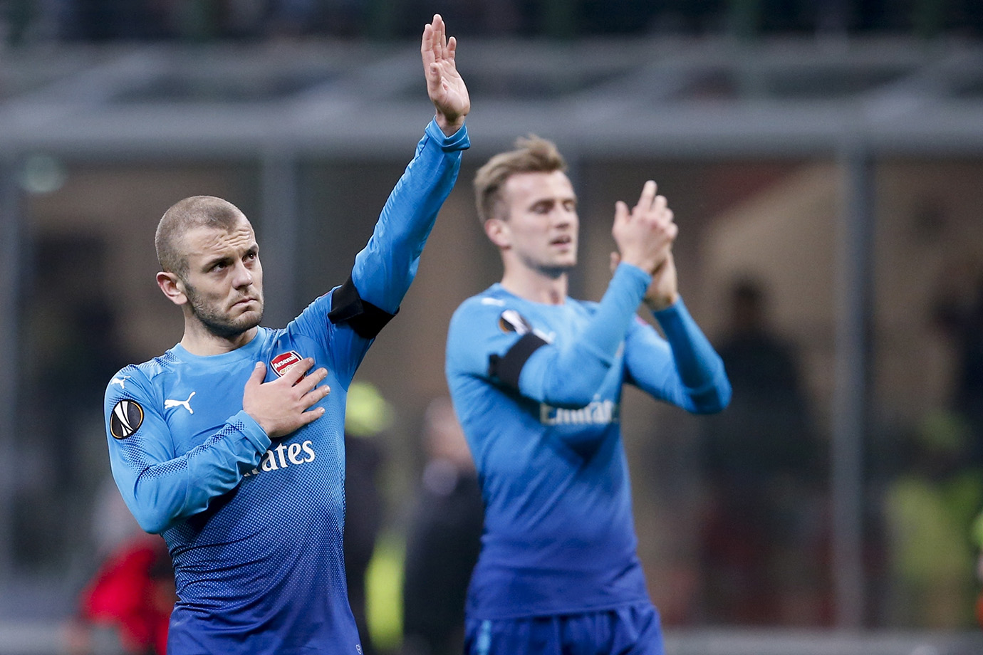Arsenal's Jack Wilshere waves to fans at the end of the match.