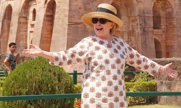 Hillary Clinton gestures outside the remains of the Hindola Mahal monument