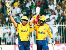 Akmal's ton carries Peshawar into play-offs