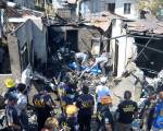 Many dead as plane crashes into house