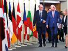 Ireland's Foreign and Trade Minister Simon Coveney and EU's chief Brexit negotiator Michel Barnier before a meeting in Brussels.