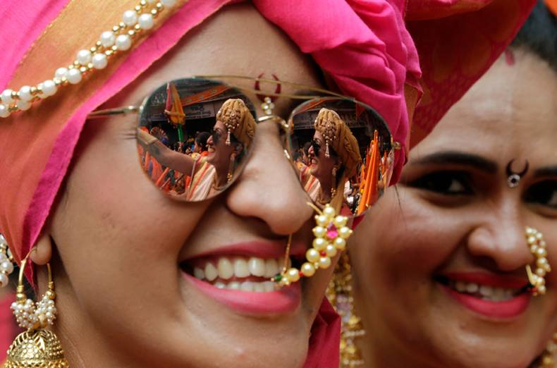 a-woman-smiles-as-she-participates-in-a-rally-to-celebrate-maharashtrian-new-year-gudi-padwa-in-mu