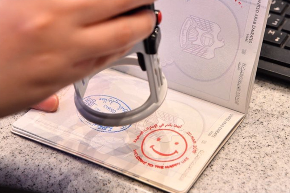 GDRFA surprises passengers with smiley face stamp on Happiness Day