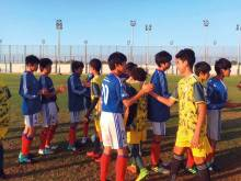 UAE, Japan players and coaches work as a team