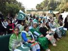 Pakistan ambasssador's wife Leena Moazzam (centre) along with the community memebers are seen during the National Day celebrations at embassy premises in Abu Dhabi