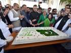 Pakistan's Ambassador Moazzam Ahmad Khan and wife Leena Moazzam cut the cake to mark the Pakistan National Day celebrations at the embassy in Abu Dhabi.