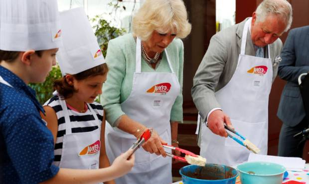Prince Charles and Camilla in a cooking section