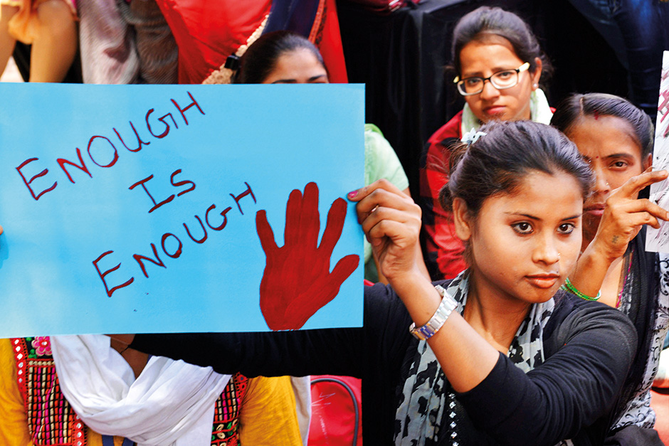 Women and children druing a dharna aganist rape incidents at Rajghat in New Delhi