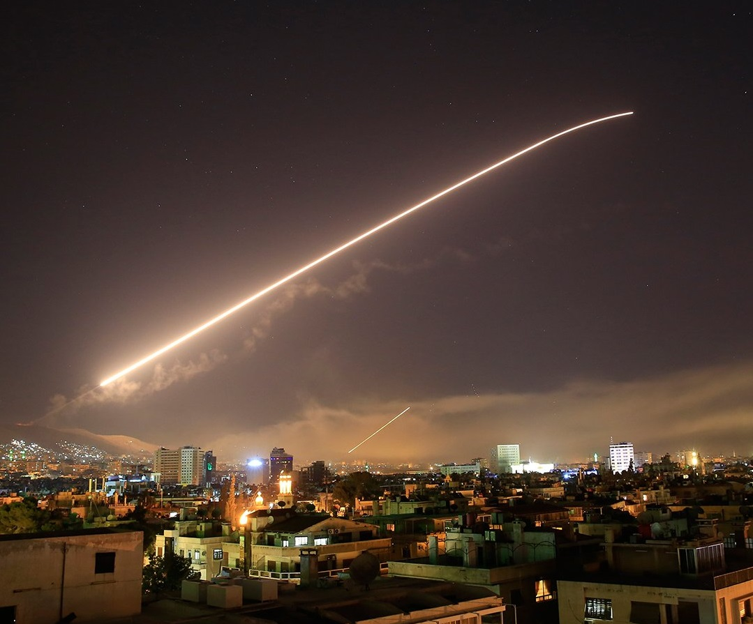 A surface-to-air missile lights up the sky over Damascus, Syria as the US and allies launch a milita