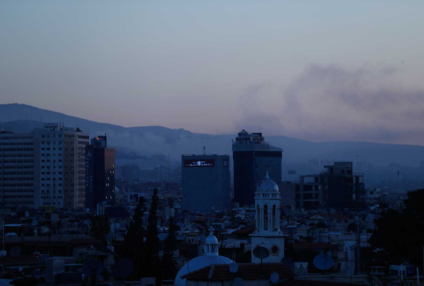Smoke rises after airstrikes targeting different parts of the Syrian capita