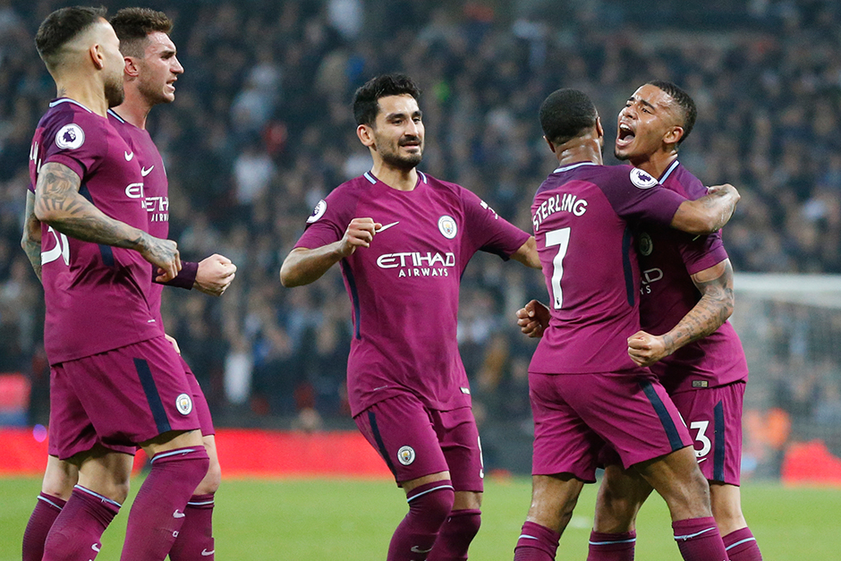 Manchester City's Raheem Sterling, second from right, celebrates with team mates