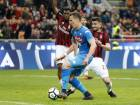 Napoli's Arkadiusz Milik (center) tries to score against AC Milan at the San Siro in Milan, Italy, Sunday. Gianluigi Donnarumma's last-gasp save denied Napoli a win during the Serie A match.