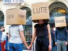 "Students wearing boxes reading ""Elite, Students, Struggle, Politics,"" perform in front of a blocked entry at the Institute of Political Studies(IEP) or Sciences Po, in Paris, France."