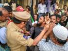 Activists being arrested by the police during a  protest against NIA court's judgment on Makkah Masjid blast case.