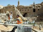 Workers restore the Al Sarreha Mosque in the Diriyah fortified complex, that once served as the seat of power for the ruling Al Saud, in Riyadh, Saudi Arabia.