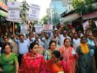 Indians carry placards and march in a rally demanding the investigation into the rape and murder of an 8-year-old girl be handed over to the Central Bureau of Investigation (CBI), in Jammu, India.