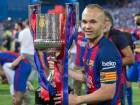 FC Barcelona´s Spanish midfielder Andres Iniesta with the trophy after winning the Copa del Rey