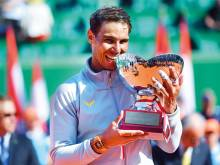 Nadal builds on his clay feat with 11th crown