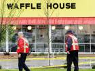 Emergency workers walk outside the Waffle House restaurant in Nashville, Tennessee, where four people died after a gunman opened fire.