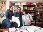 Pasquale Marinelli, co-owner of the Fonderia Pontificia Marinelli, left, Armando Marinelli, co-owner of the Fonderia Pontificia Marinelli, center, and Paola Patriarca, wife of Armando, right, look at paperwork in the offices of the Fonderia Pontificia Marinelli bell foundry in Agnone, in the Molise region of Italy.