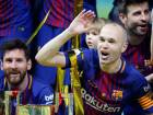 Barcelona's Andres Iniesta, right, celebrates after the Copa del Rey final soccer match between Barcelona and Sevilla at the Wanda Metropolitano stadium in Madrid, Spain, Saturday, April 21, 2018.