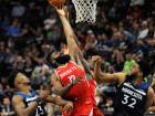James Harden (#13) of the Houston Rockets tips the ball against Jimmy Butler (#23) and Karl-Anthony Towns of the Minnesota Timberwolves during the fourth quarter.