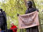 Britain's Prime Minister Theresa May speaks during the unveiling of a statue of suffragist and women's rights campaigner Millicent Fawcett, by British artist Gillian Wearing, in Parliament Square in London