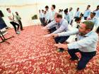 Taxi drivers go through an exercise routine during the Watch Your Campaign at DTC headquarters in Muhaisnah.