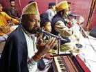 Pakistani Qawwali (Sufi devotional music) singers Azmat Sabri (L) and his brother Talha Sabri (R) perform with their group during an event in Karachi.