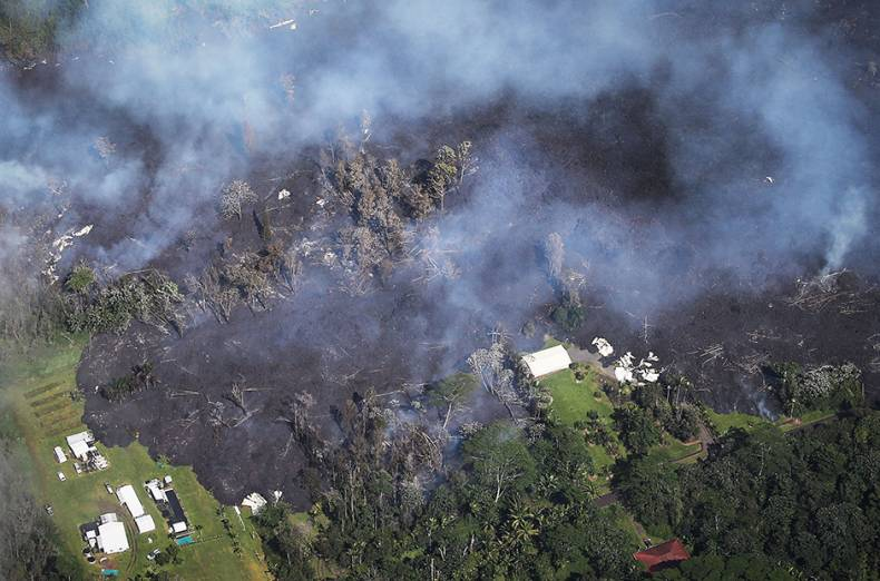 lava-from-volcanic-fissures-slowly-advances-and-overtakes-structures-and-trees