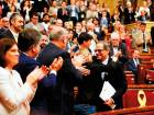 MPs applaud after a speech by Junts per Catalonia (Together for Catalonia) MP and presidential candidate Quim Torra (right) as he hugs fellow MP Elsa Artadi during a session at the Catalan parliament in Barcelona.