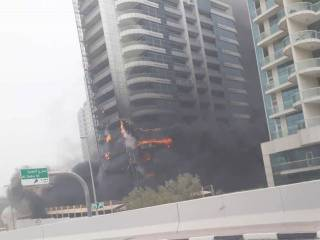 Report: Zen Tower fire started on balcony