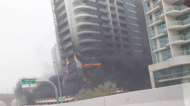 Fire razes a building in the Dubai Marina on May 13, 2018