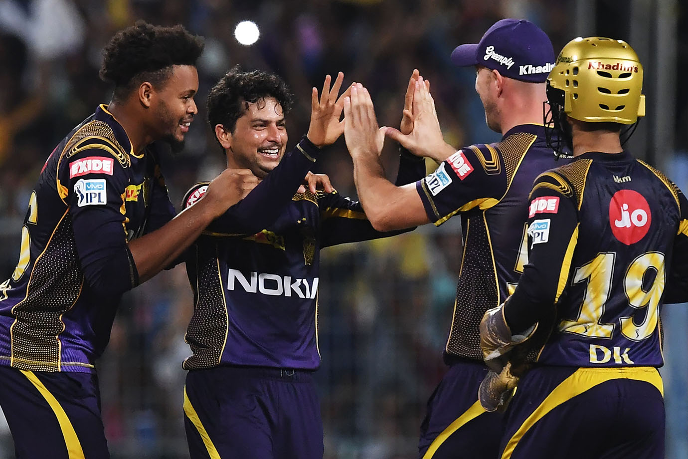 Kolkata Knight Riders' Kuldeep Yadav (2ndL)  celebrates with teammates after taking the wicket of Ra
