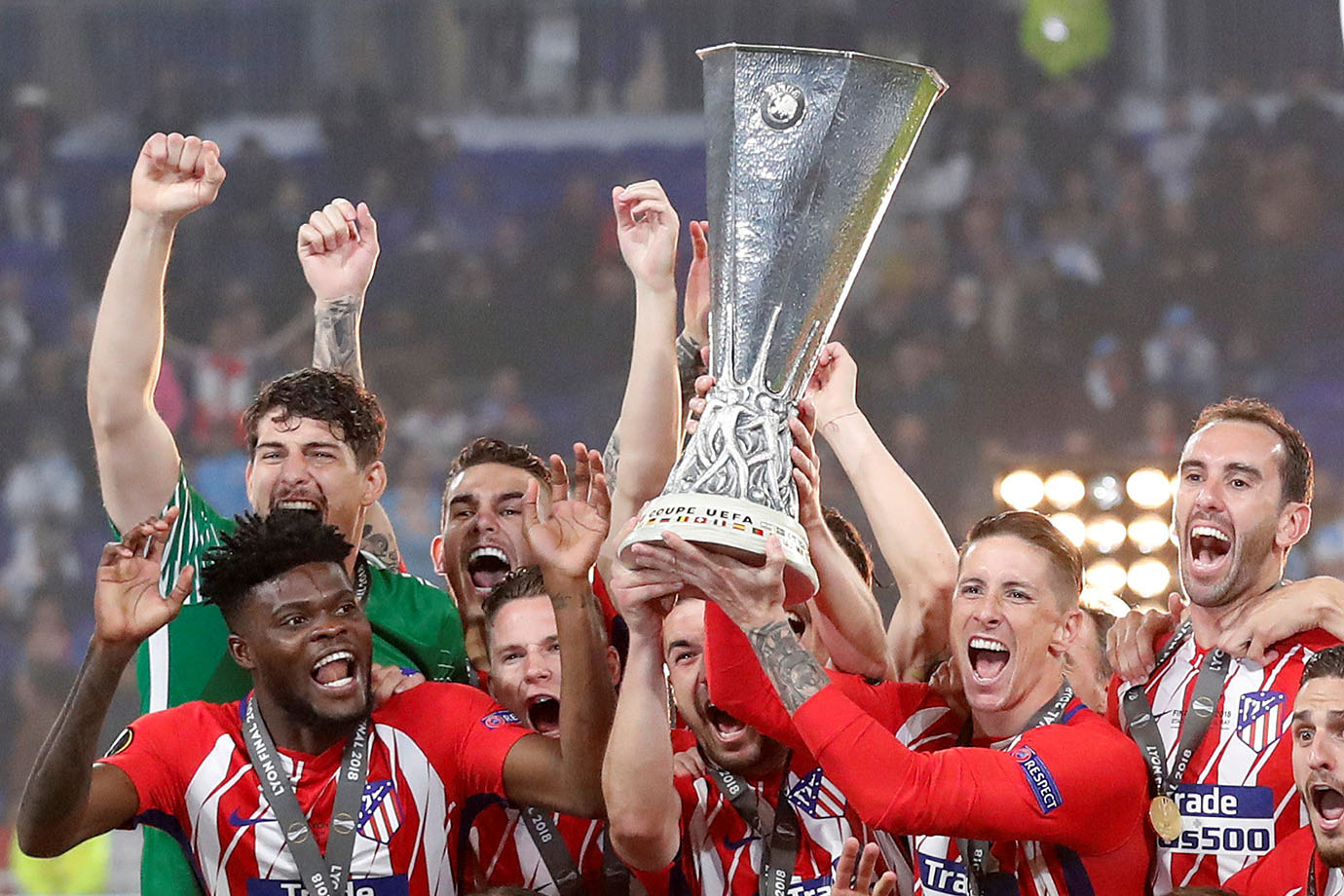 Atletico Madrid's Gabi and Fernando Torres lift the trophy as they celebrate winning the Europa Leag