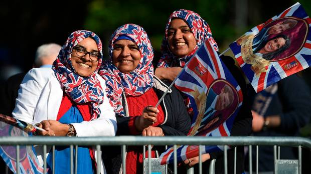 Well-wishers with Union Flags stand at the barriers on the Long Walk leading to Windsor Castle
