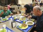 Syrian refugees Mohamd Dahhan, left, his 3-year-old son Adam, wife Razan Suliman, and father in law Jamal Suliman, right, break their fast at the oldest mosque in Latin America during the first day of the holy fasting month of Ramadan, in Sao Paulo, Brazil, Thursday, May 17, 2018. (AP Photo/Andre Penner)