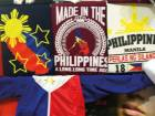 T-shirts emblazoned with colours of the Philippine flag are among hot sellers at Al Attar Shopping Centre.
