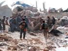 Afghan security forces inspect the site of a blast in Kandahar province, Afghanistan May 22, 2018.