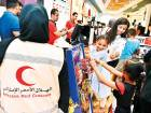 Rawafed Centre volunteers take underprivileged children to the RedTag department store for shopping on Monday.