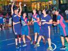 Action from the 3x3 basketball title contest between the Gems team and Rim Rockers.