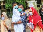 People wear safety masks as a precautionary measure after the 'Nipah' virus outbreak, at Kozhikode Medical College, in Kerala on Friday.