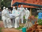 Doctors and relatives wearing protective gear carry the body of a victim, who lost his battle against the brain-damaging Nipah virus, during his funeral at a burial ground in Kozhikode, in the southern Indian state of Kerala, India, May 24, 2018.
