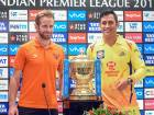 Sunrisers Hyderabad captain Kane Williamson and Chennai Super Kings captain Mahendra Singh Dhoni pose with VIVO IPL cricket T20 trophy during press conference in Mumbai on Saturday.