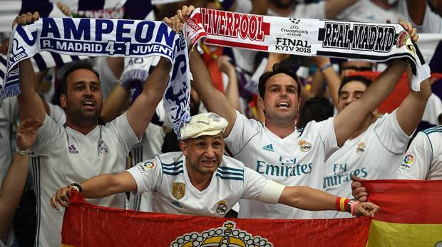 Real Madrid's supporters hold scarves and flags prior to the UEFA Champions League final