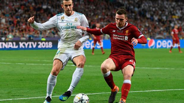 Real Madrid's Gareth Bale (L) vies with Liverpool's Andrew Robertson
