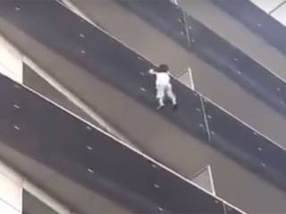 Watch: Hero climbs 4 floors to save toddler