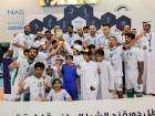 The Emirates Driving Institute team celebrate their triumph in the NAS Futsal Championship. They beat Al Bahri 3-2 on penalties after finishing tied 5-5 at the end of extra-time.