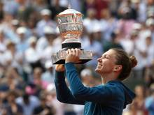 Halep digs deep for first Grand Slam title