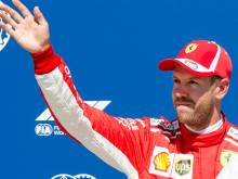 Vettel claims pole with record lap at Canada